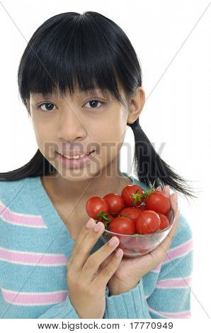 little girl holding bowl of tomatoes