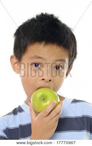 asian little boy eating a hamburger