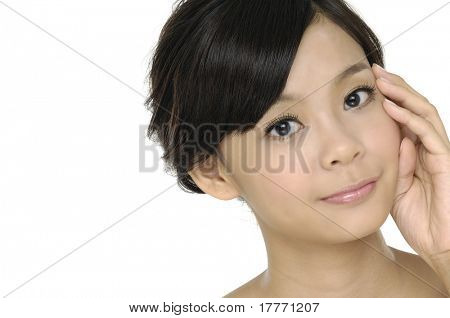Beautiful young woman stroking her clean beauty face