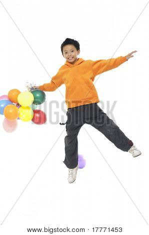 Cute little boy with the balloon jump