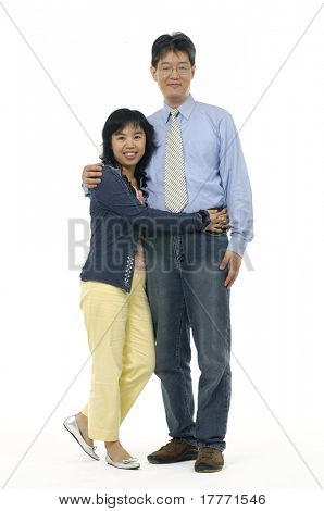 A husband wraps his arms around his pregnant wife belly. Isolated on white.