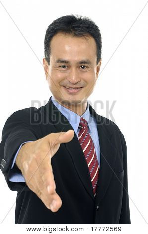 young businessman extending his hand welcoming you into his office