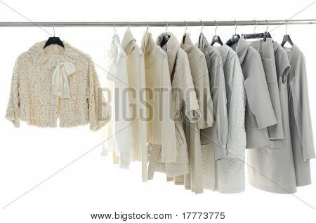 Designer clothing hanging as display.