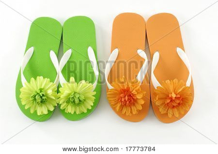 Colorful flipflop sandals on the white