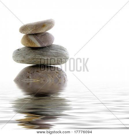 Pebbles stacked with water reflection