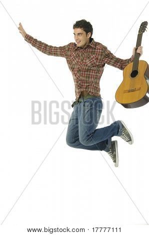 Guitar player jumping in midair isolated on white