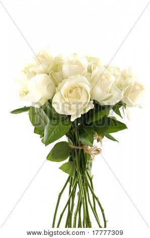 A vase of glass with a bunch of white roses