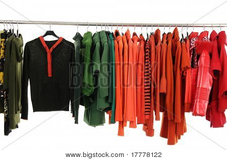 Colorful female coat on hangers at the show