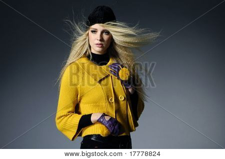 fashion model posing at gray background