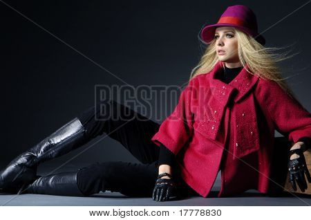 fashion model sitting at black background