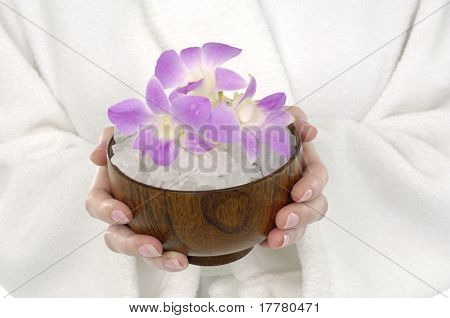 young woman holding bowel of orchid