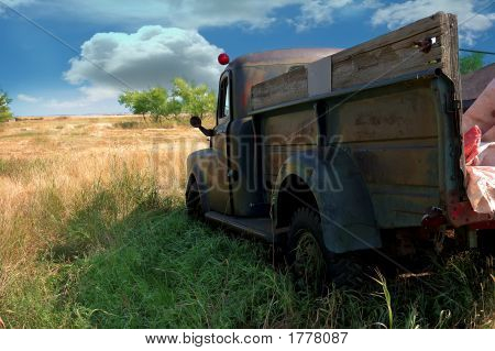 Rusty Old Truck Sitting In Retirement
