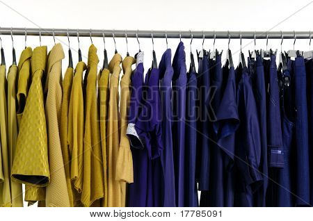 Designer fashion clothing hanging as display