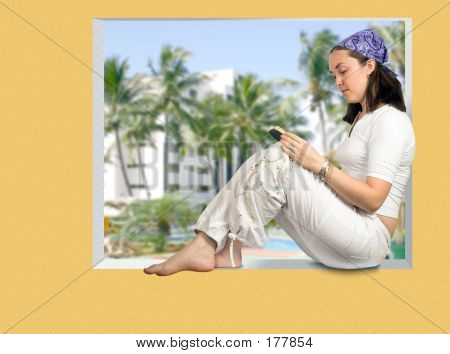 Beautiful Girl Reading In A Tropical Resort