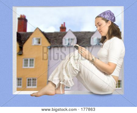 Casual Girl Reading A Book On A Window Sill