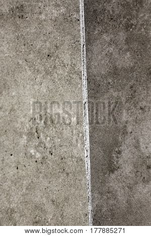 Corner of a home bathroom tile shower wall grout that is cracked in the corner of the wall. Shower wall that has split grout in the wall corner and needs to be fixed