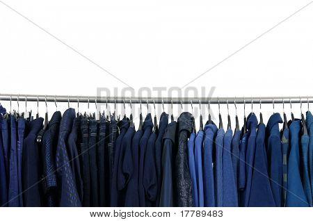Designer fashion clothing a row of on hangers in a row