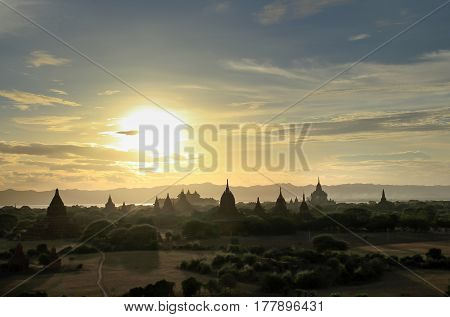 Amazing famous travel and landscape scene of ancient temples and carriages at sunset in Bagan Myanmar. Top of the best destination of asia. Stock photo ID: 302572958