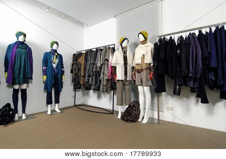Boutique display mannequins in fashionable dresses in fashion store