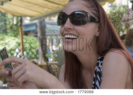 Laughing Woman At A Cafe