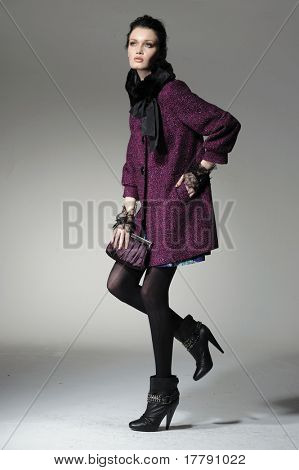 fashion model in fashion dress posing in light background