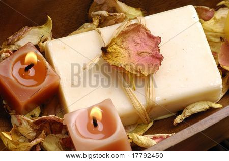 Bowl of burning candle with natural handmade with rose withered petals