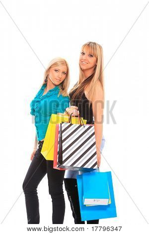 Two teenagers girls doing shopping. isolated