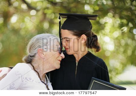Happy graduate with grandmother celebrating graduation. Closeup, shallow DOF.