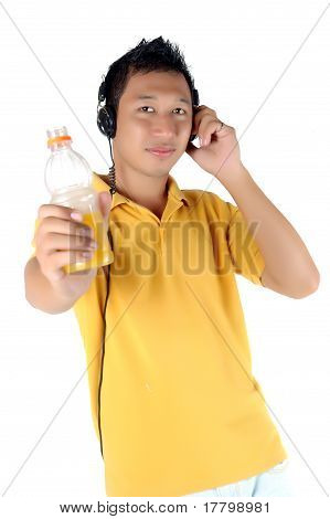 Young Man Listening To Music While Brandishing His Drink Bottle