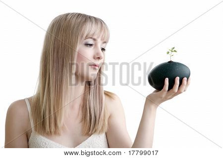 Pretty blonde girl holding an emu egg
