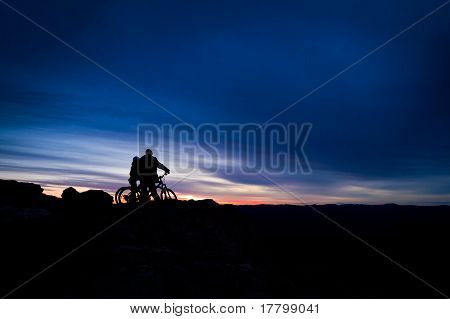 Mountain bike riders atop a mountain