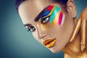 Fashion Model Girl with colored face painted. Beauty fashion art portrait of beautiful woman with co poster