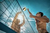 Beach Volleyball players in sunglasses under sunlight. Dynamic sport action near the net, outdoor. poster