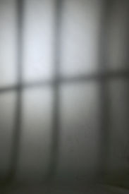 pic of atonement  - Jail bars shadow on bleak prison wall - JPG