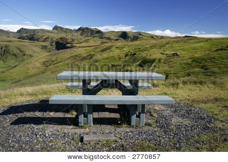 Wooden Bench In Beautiful Landscape