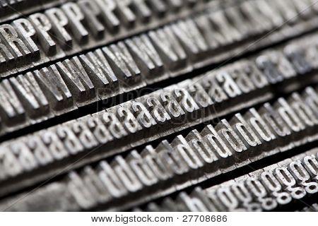 Error tipográfico móvil metal antiguo