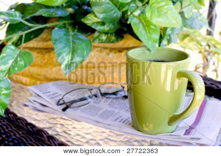 Closeup Of Morning Coffee And Newspaper