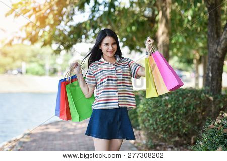 Young Woman Shopping Outside Lady