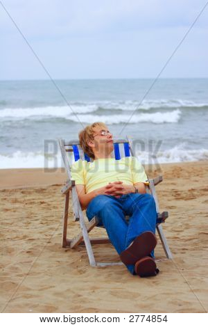 Young Man On Sea Beach In Lounge