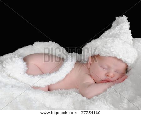 Adorable Newborn In Hat Sleeping On A White Blanket.isolated