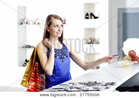 woman at shopping checkout paying credit card