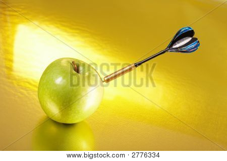 Exact Hit Of A Dart In A Golden Apple
