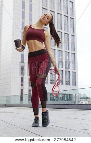 poster of Fitness Sporty Woman During Outdoor Exercises Workout. Beautiful Fit Girl With Fitness Elastic Band.