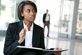picture of academia  - A pretty african american business woman at her company - JPG