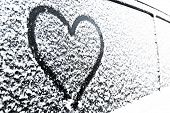 Heart Symbol On Frozen Window Of The Car. Shape Of Heart Drawn On Snow On Front Window Of The Car. H poster