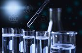 Researcher With Glass Laboratory Chemical Test Tubes With Liquid For Analytical , Medical, Pharmaceu poster