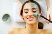 Beautiful Young Woman Getting A Face Treatment At Beauty Salon.skin And Care. Beautiful Woman Lying  poster