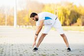 Fitness. Stretch Man Doing Stretching Exercise. Standing Forward Bend Stretches Of Legs poster