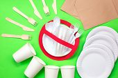 No Use Symbol In Red Forbidden Sign With Plastic Dishes Around Disposable Paper Dishes And A Wooden  poster