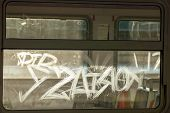 Graffiti Inscriptions Scratched On The Windows Of Electric Trains Illuminated By Backlight Against T poster